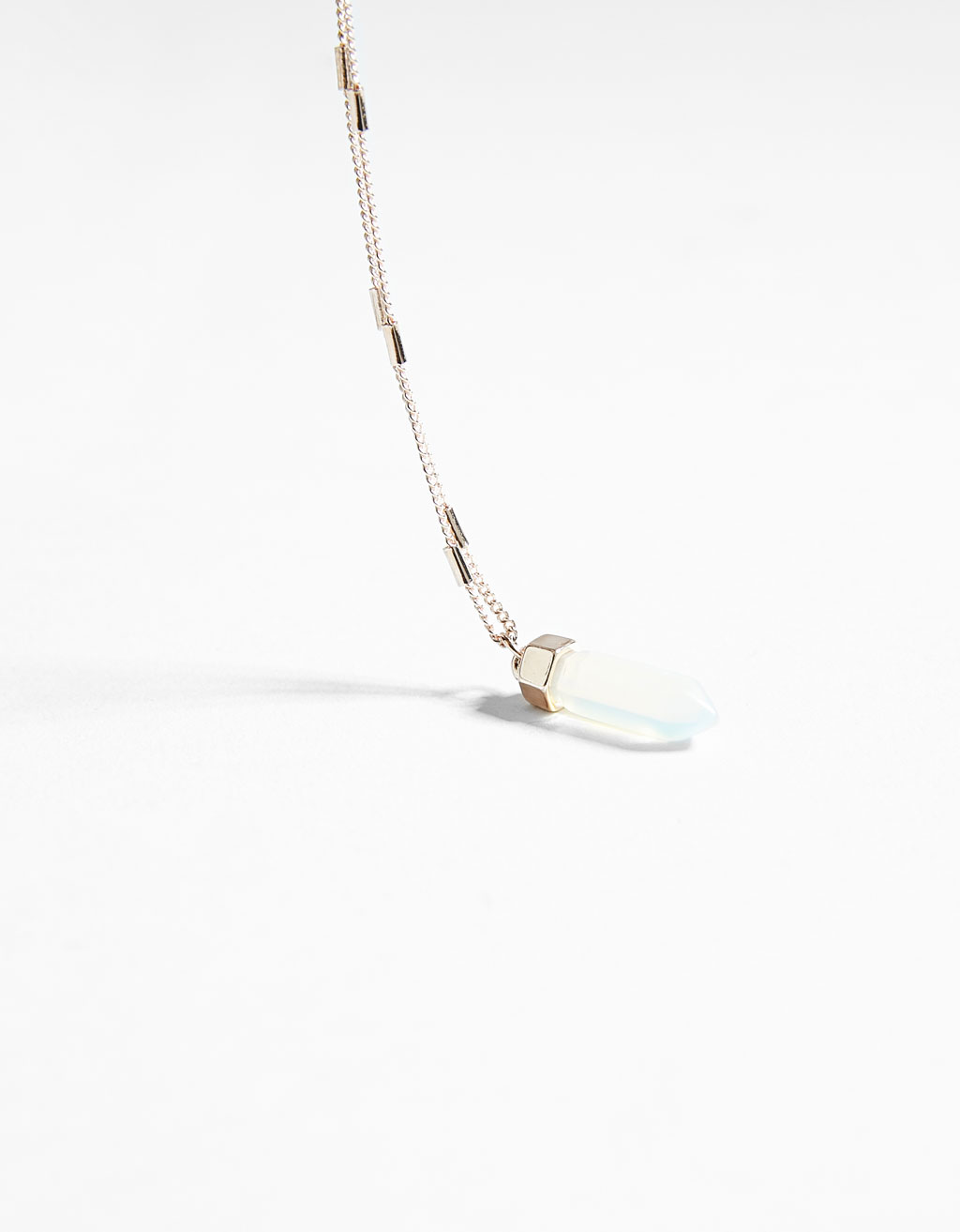 Necklace with transparent stone pendant