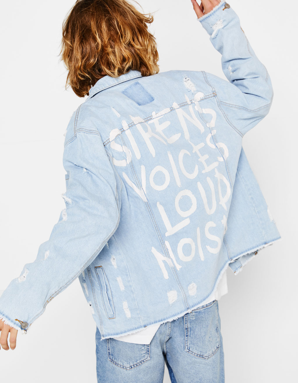 Ripped denim jacket with printed back