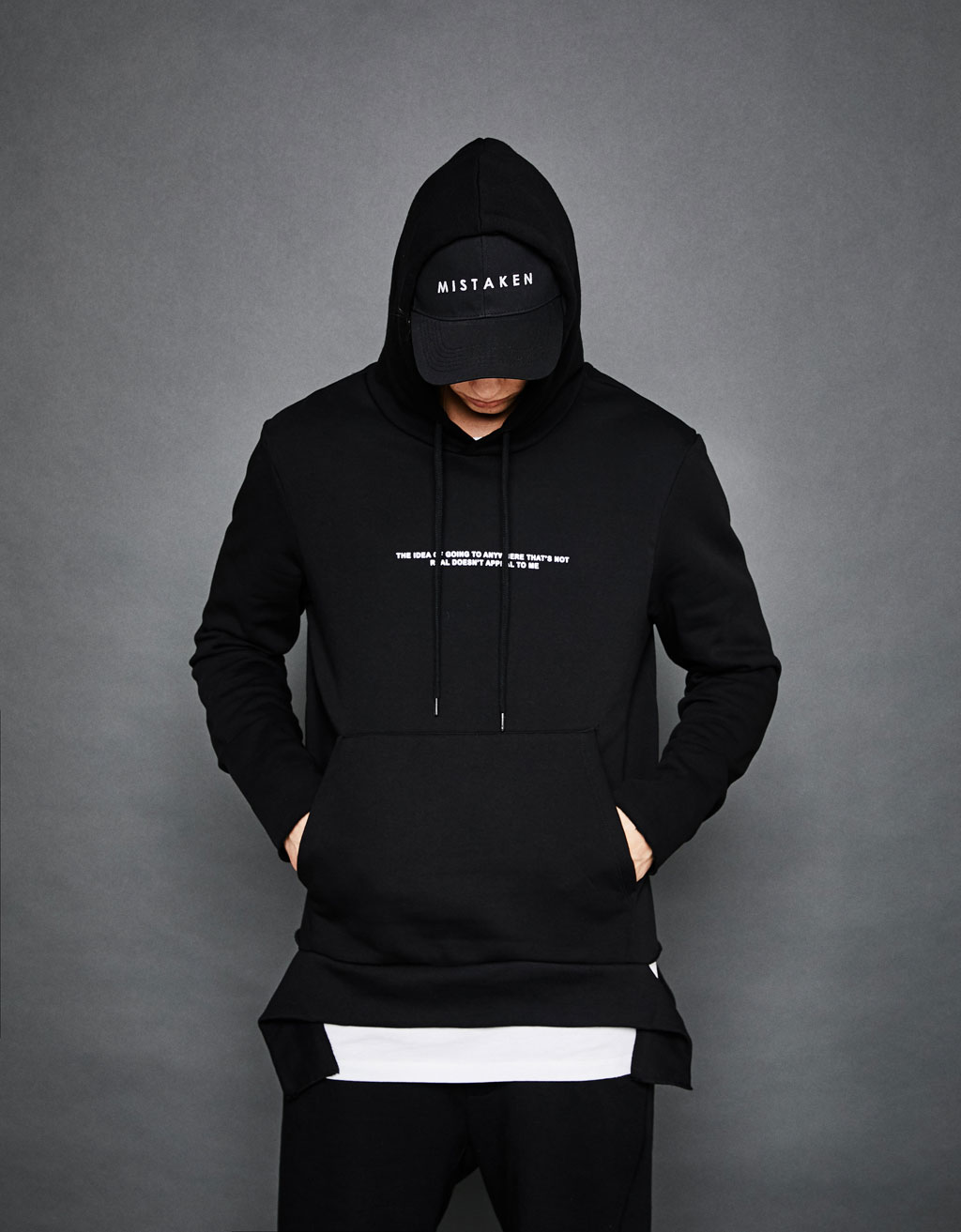 Sweatshirt with slogan and hood