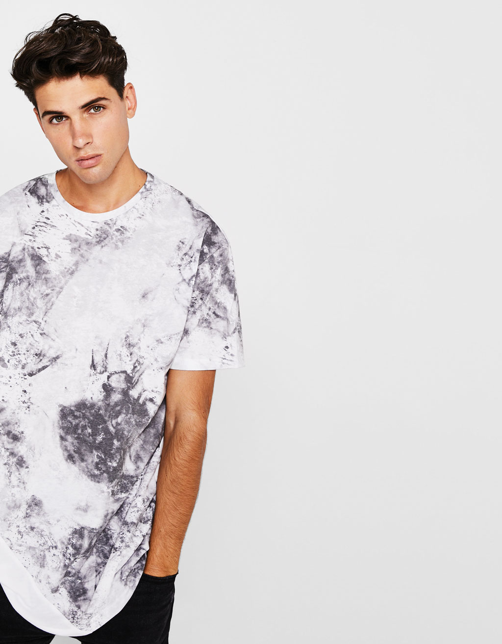 Textured camouflage print T-shirt with slogan