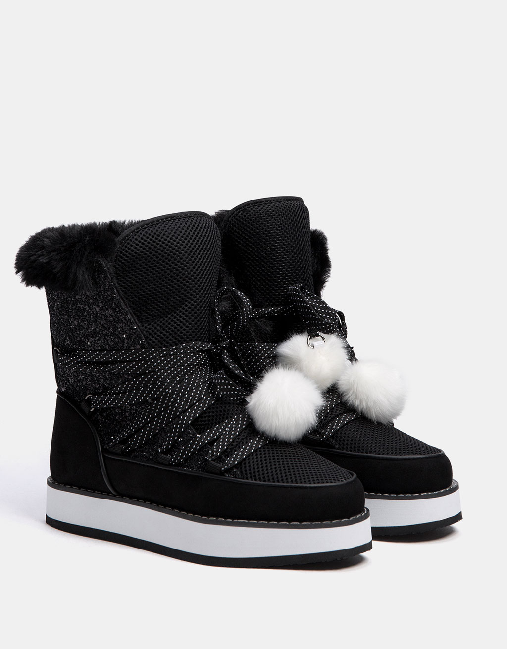 Platform ankle boots with faux fur and pompoms