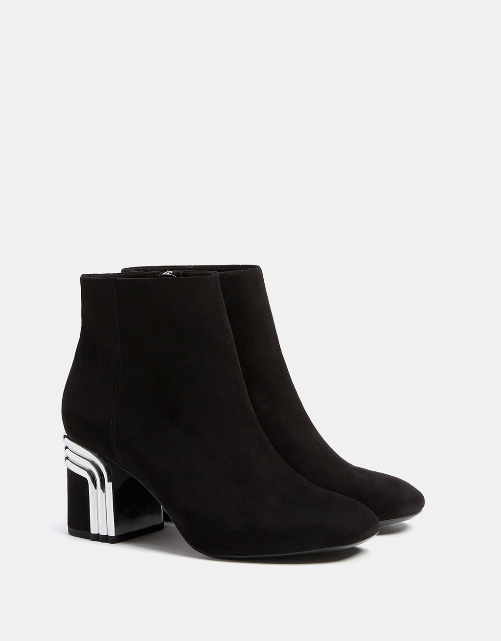 Mid heel ankle boots with metal detail