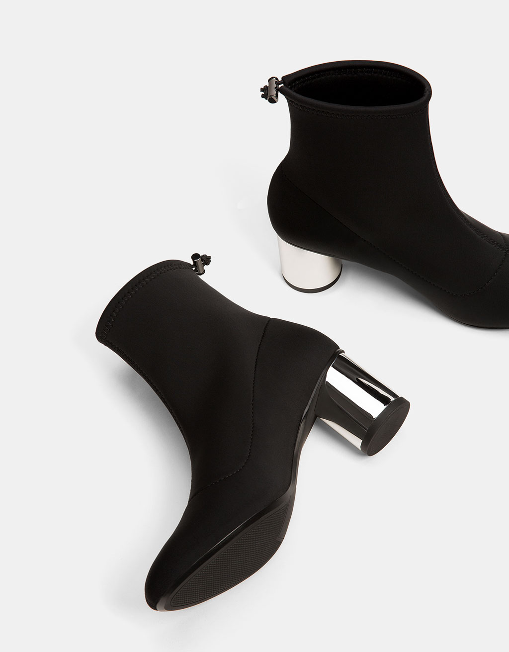 Neoprene-like mid heel ankle boots with metal heels