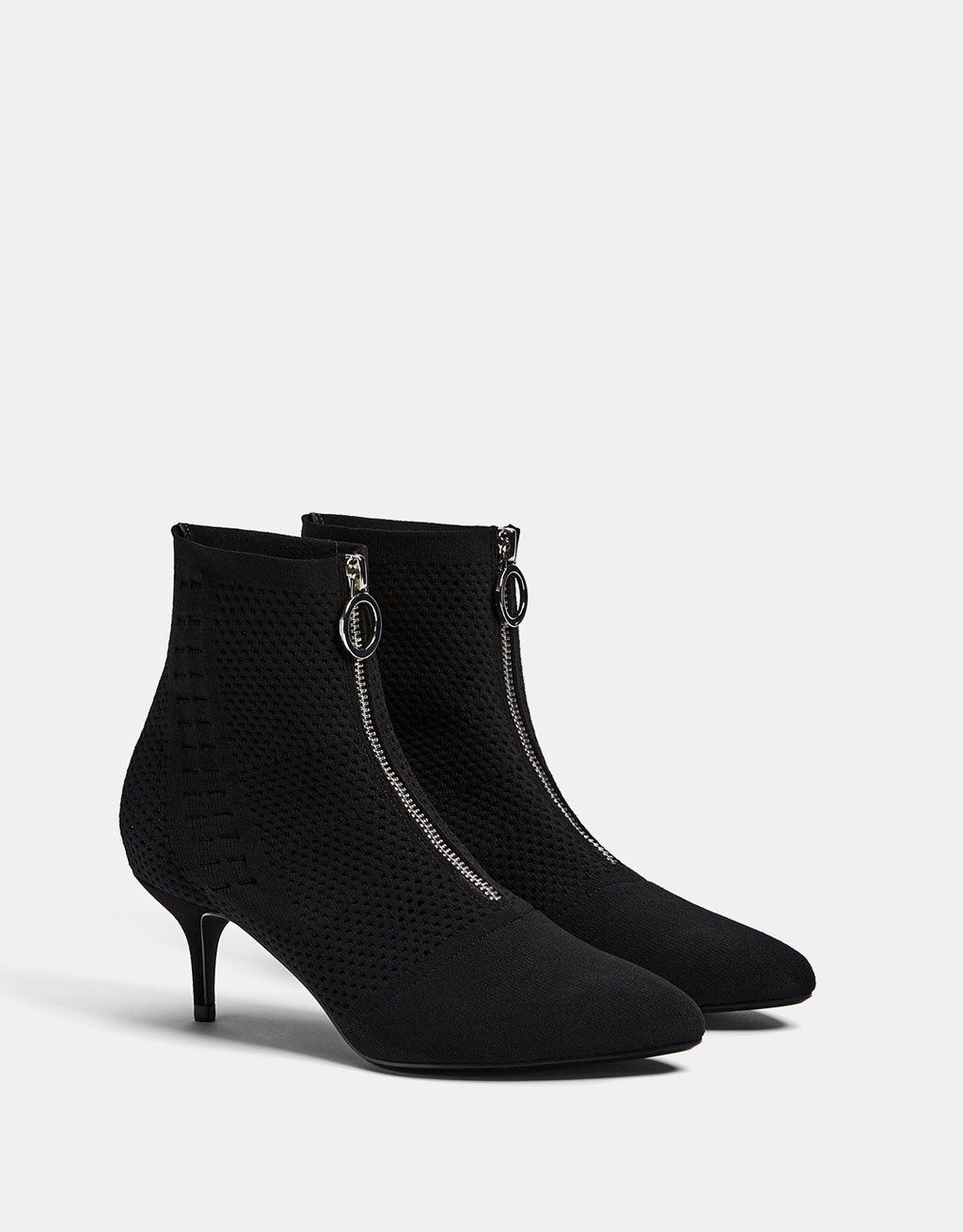 Mid heel sock-style ankle boots with front zip