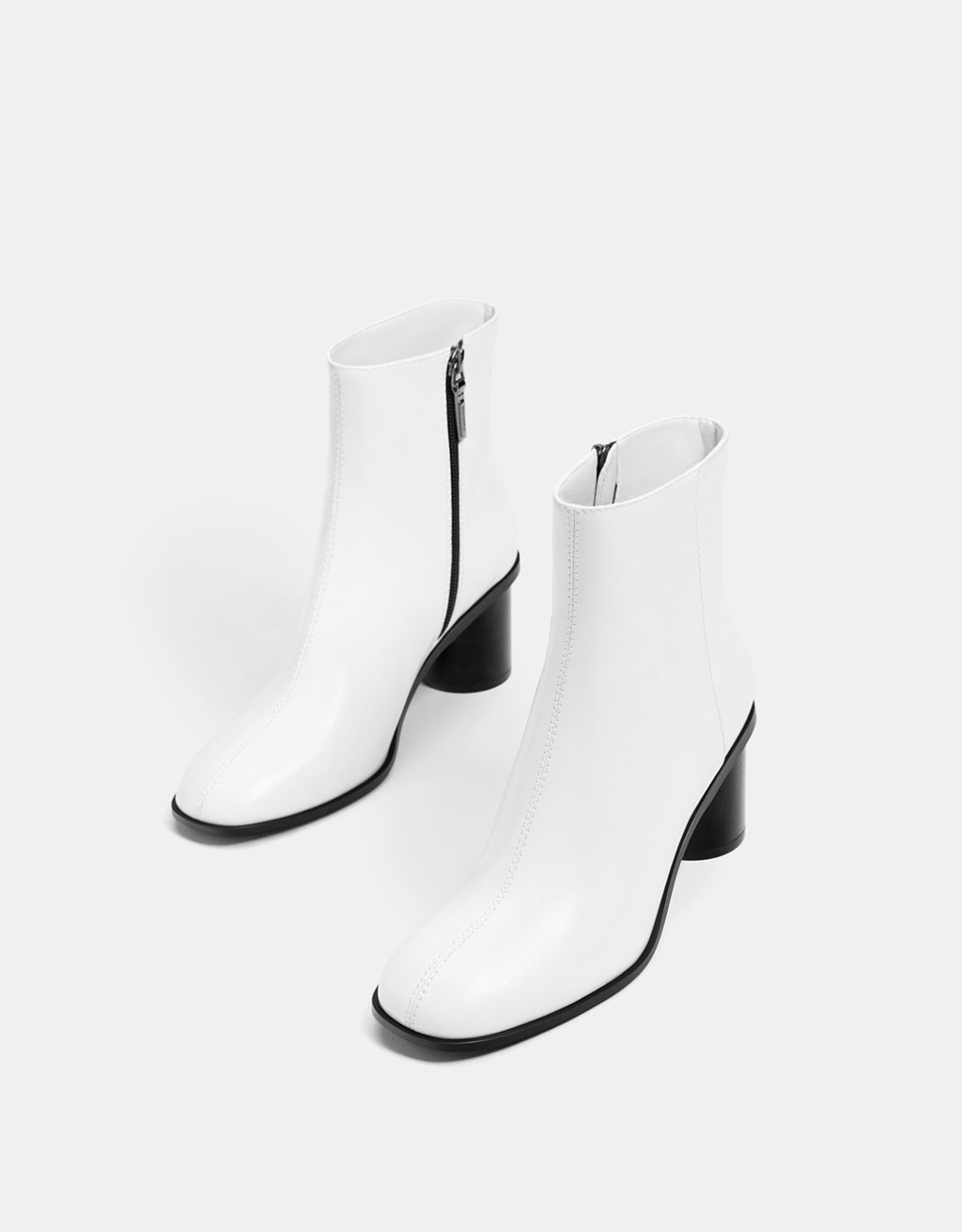Mid-heel ankle boots with contrasting zips