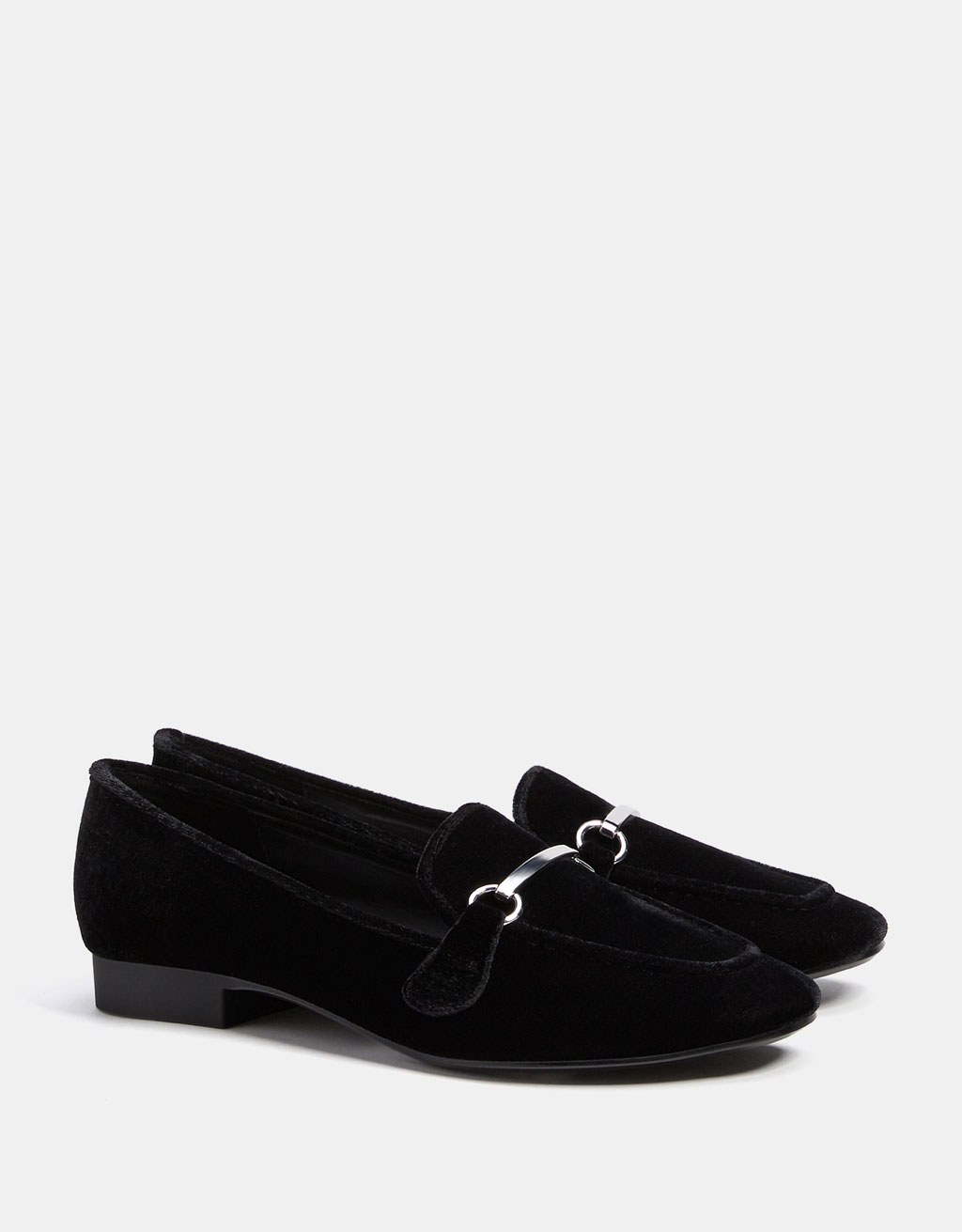 Velvet loafers with metallic appliqué.
