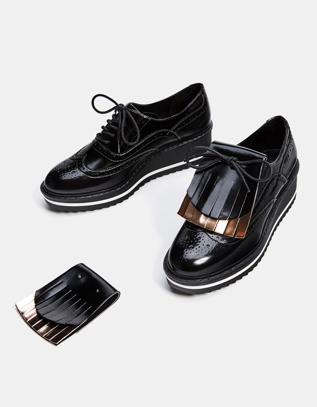 Flatform sneakers with broguing and removable, interchangeable foldover tongue