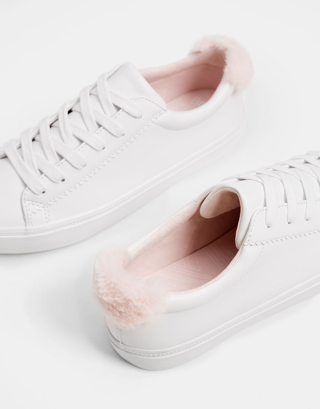 Lace-up sneakers with faux fur trim