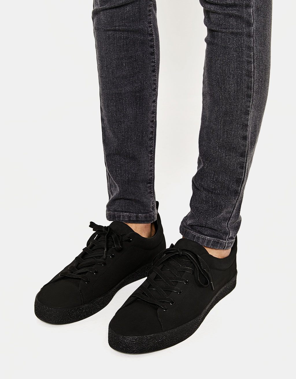 Men's black sneakers with textured soles