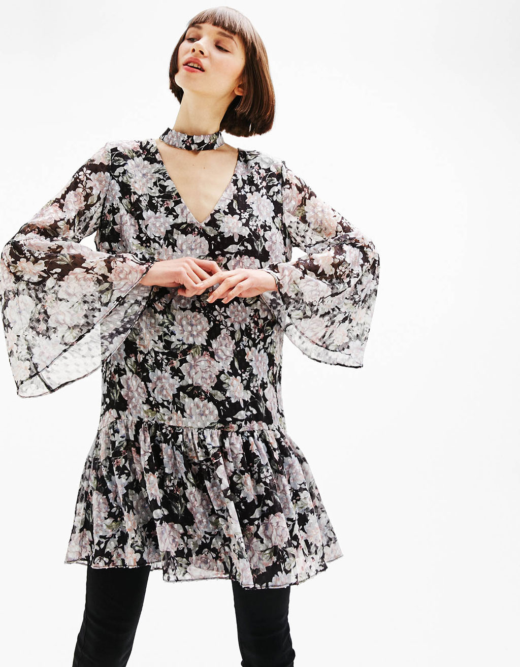 Floral print dress with flared sleeves.