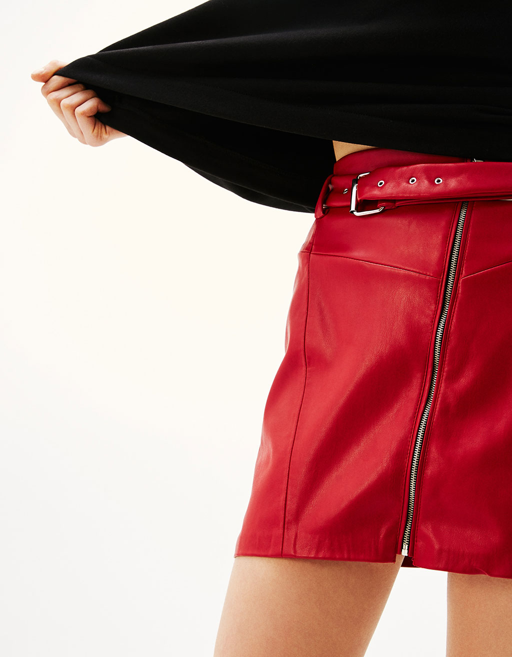 Faux leather skirt with pockets and zips