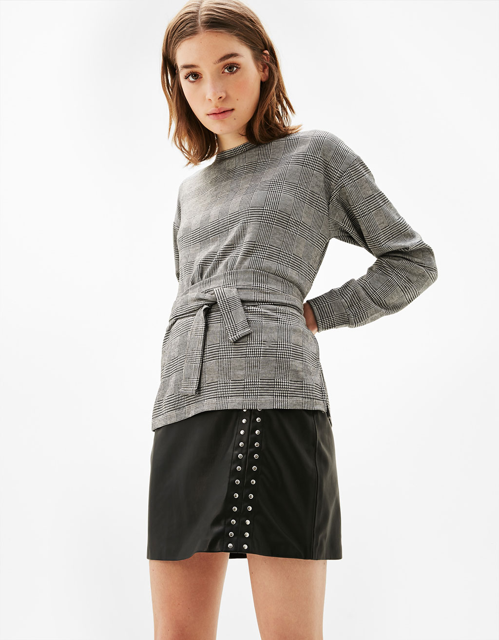 Short leather-effect skirt with studs