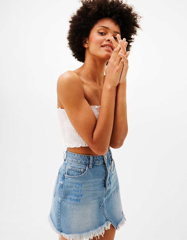 Asymmetric denim skirt with slogan