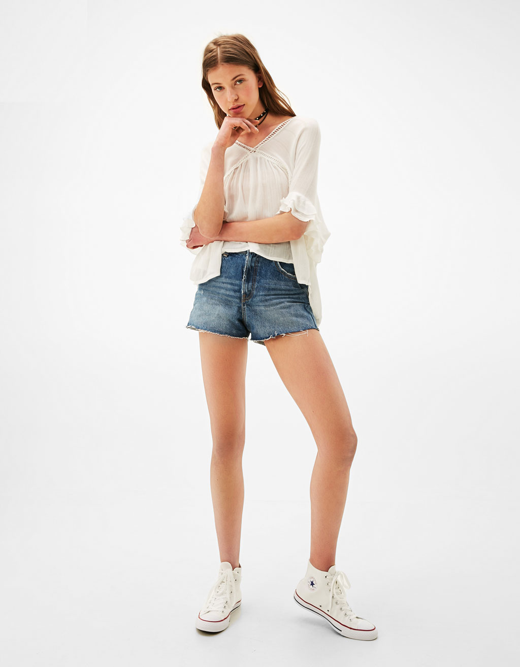 Loose-fitting blouse with knotted details