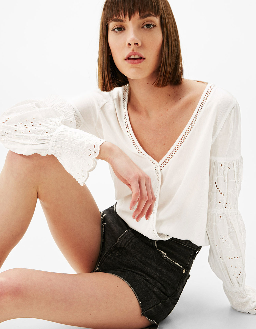 Embroidered blouse with crossed V-neckline