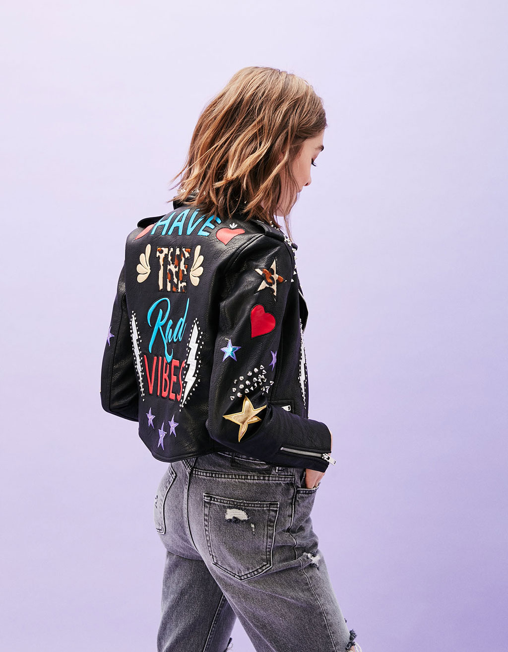 Faux leather biker jacket with back text