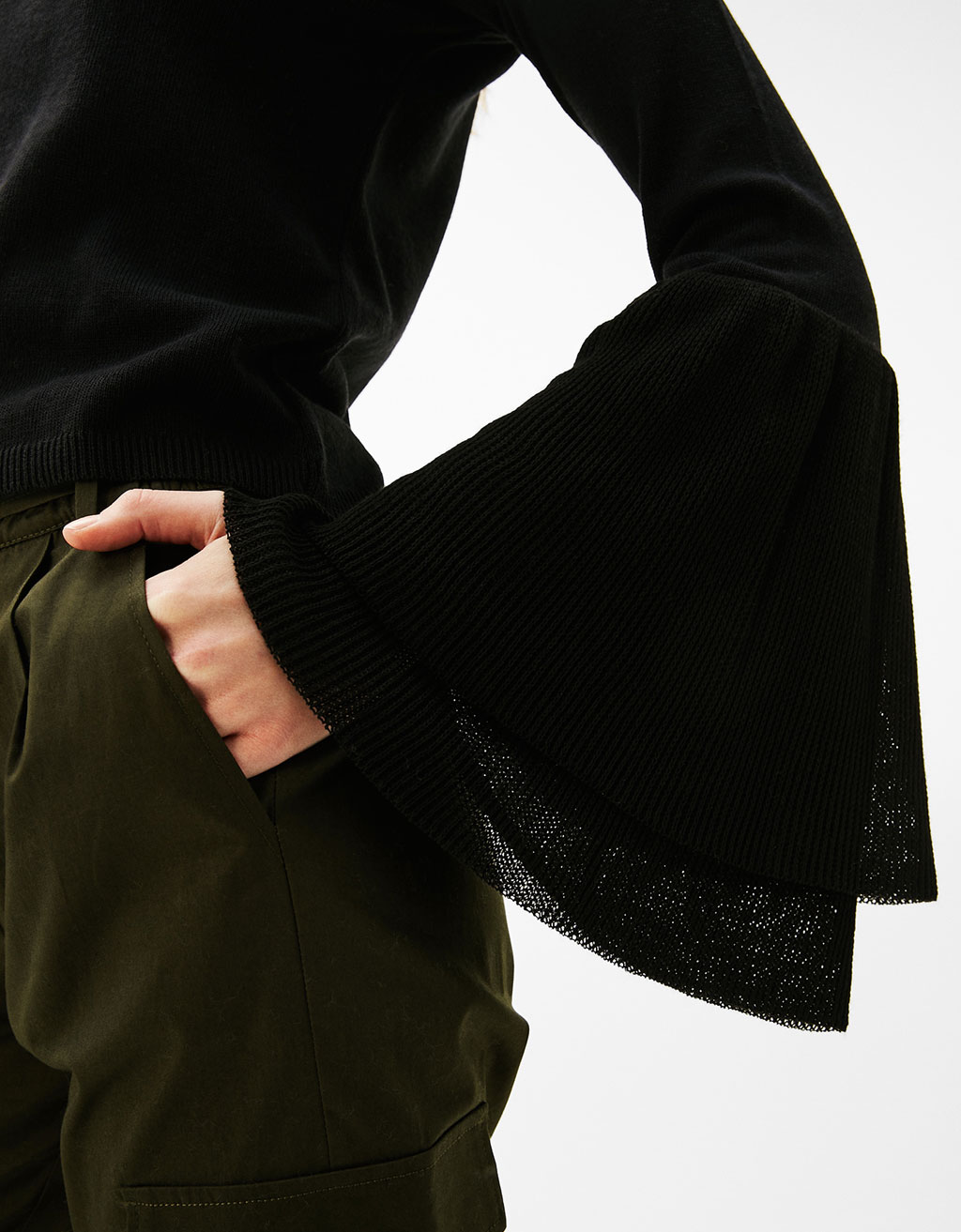 Sweater with frills and flared sleeves