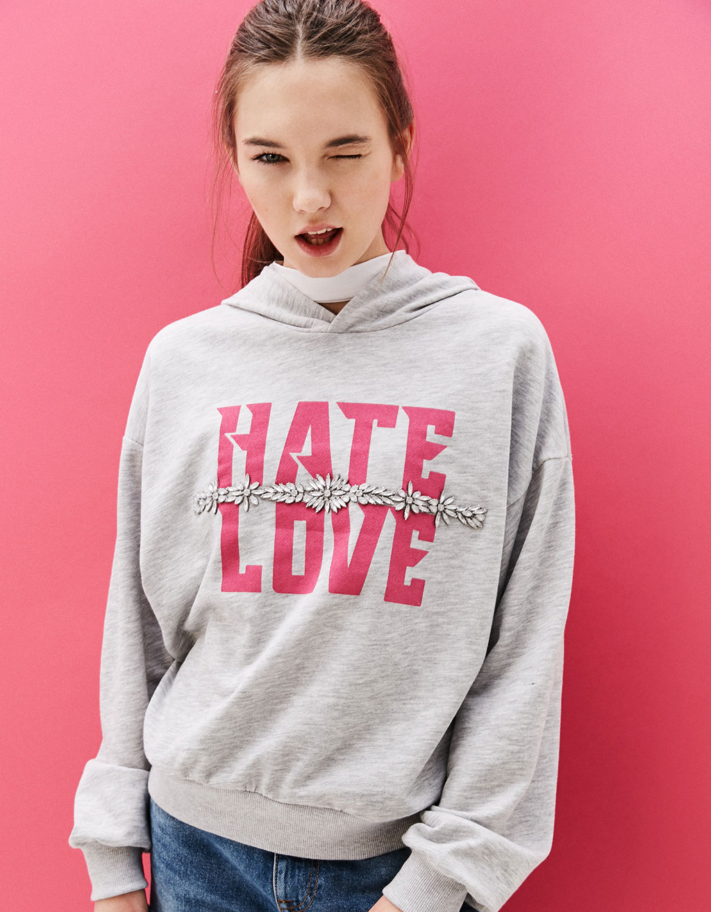 Hooded sweatshirt with gem and text