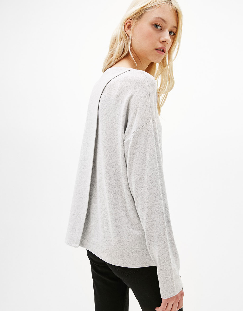 Sweater with back slit