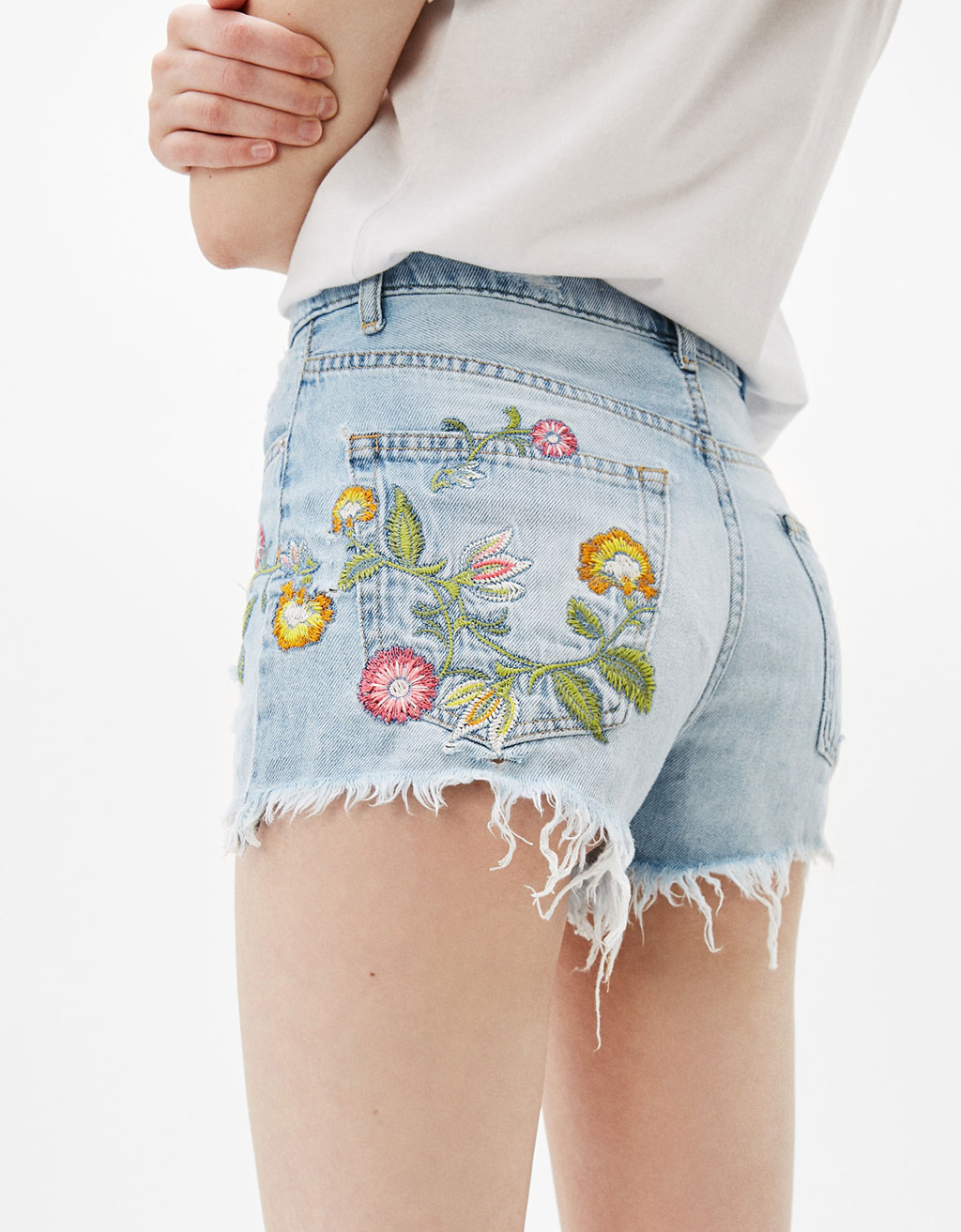 Denim shorts with embroidered flowers