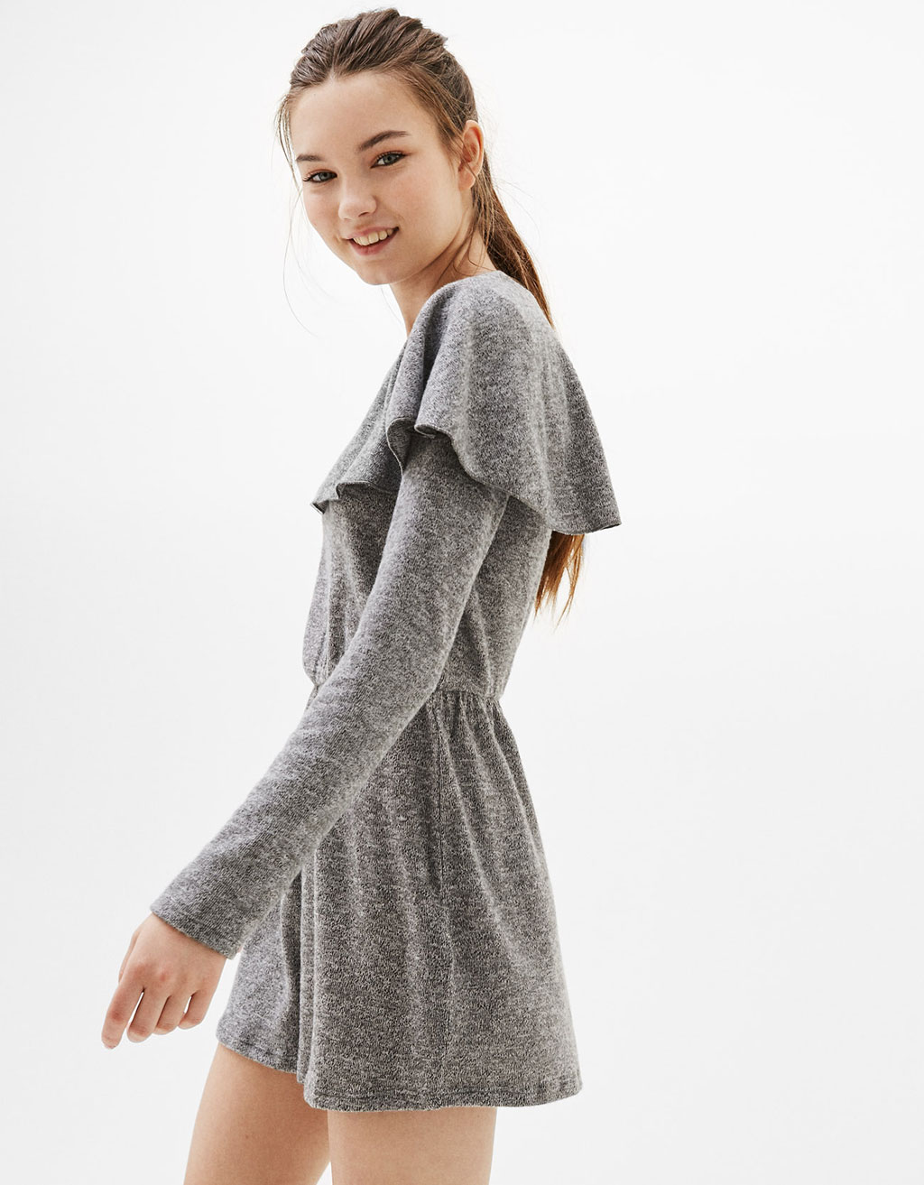 Short tricot jumpsuit with frill cape