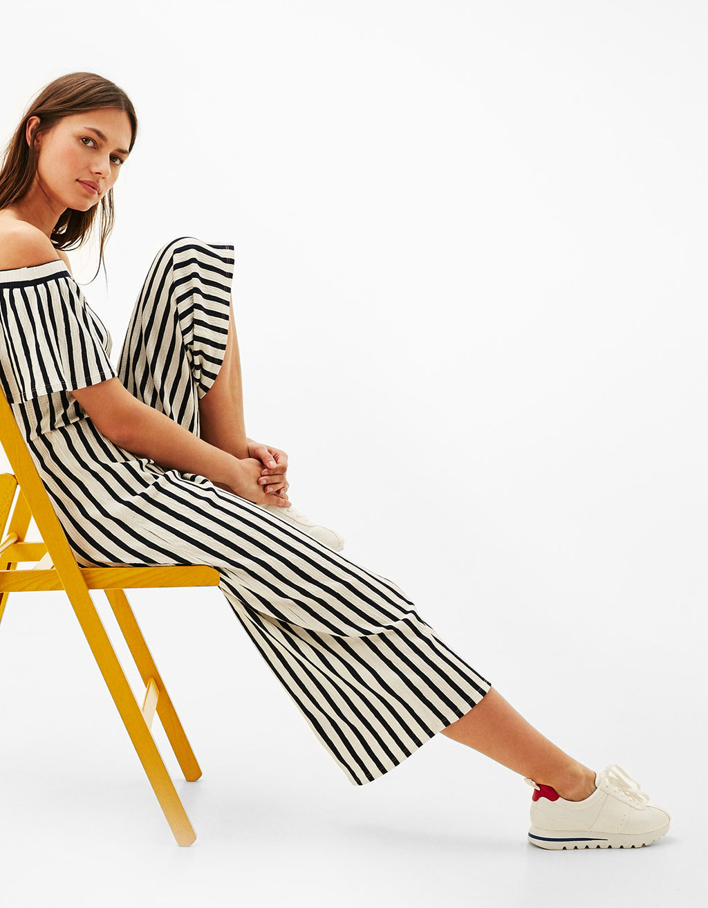 Long off-the-shoulder striped jumpsuit