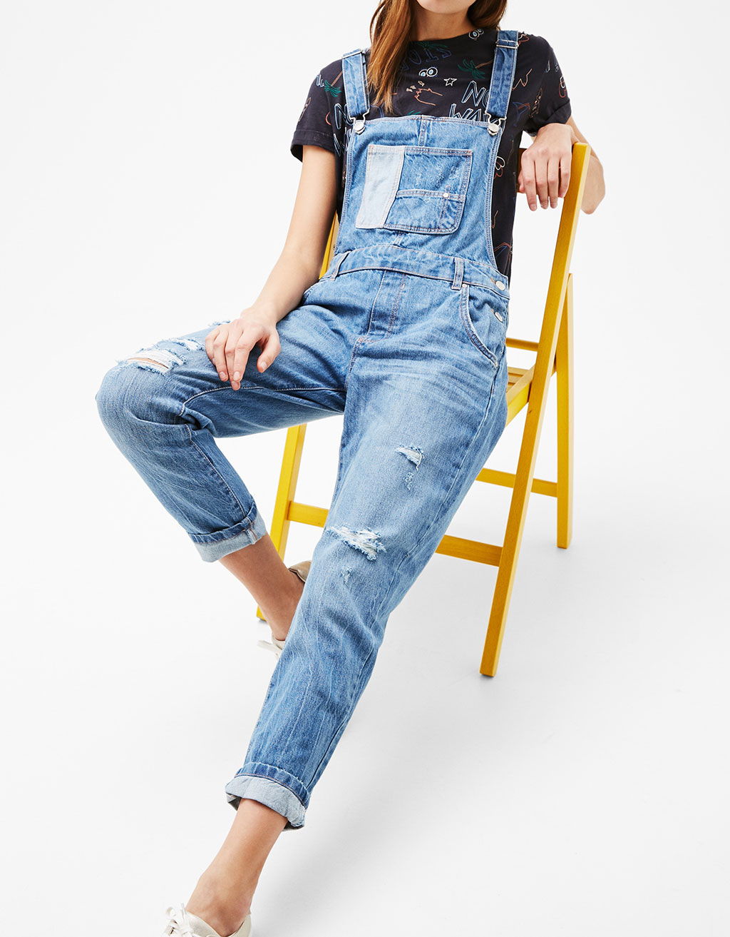 Ripped denim dungarees