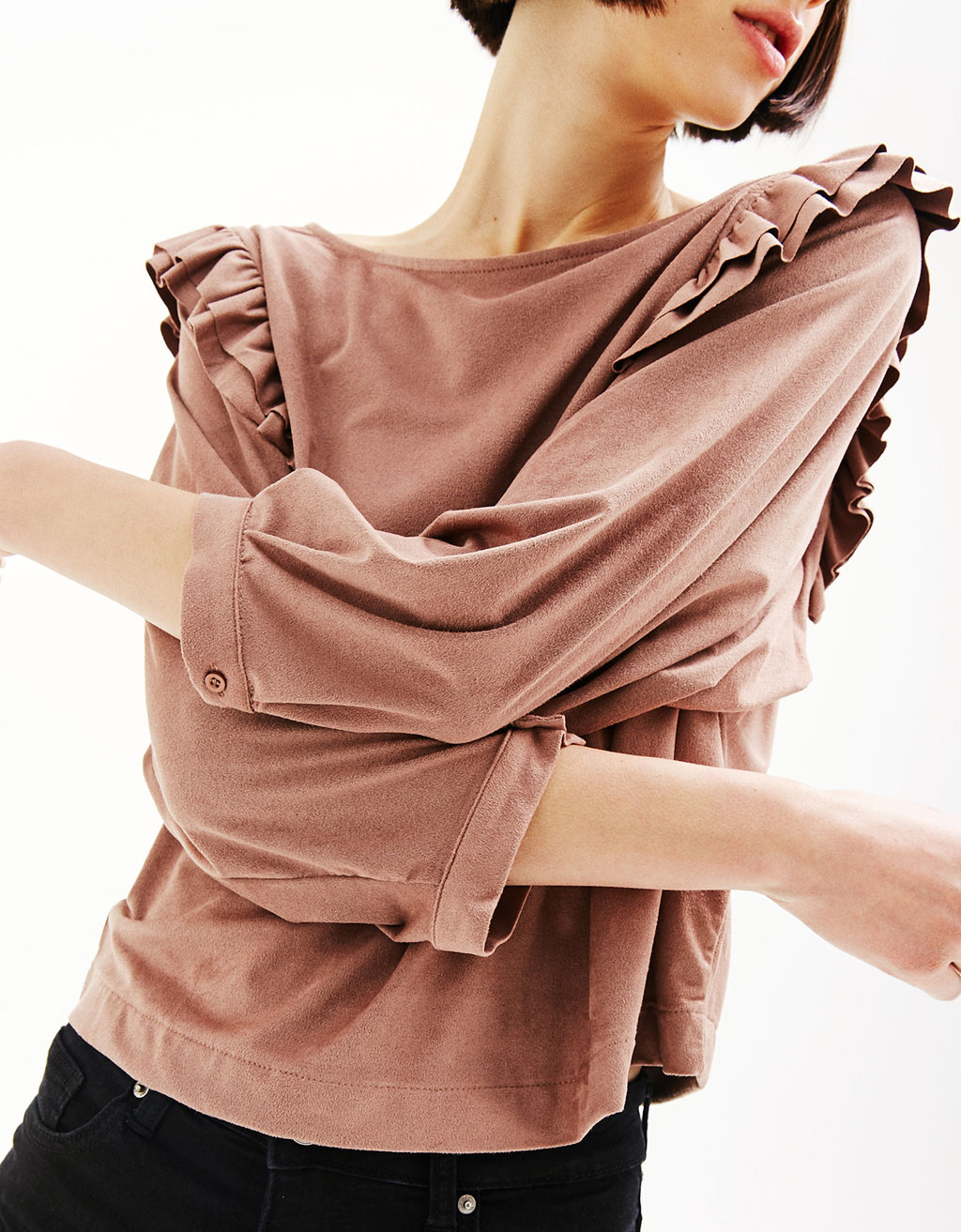 Blouse with frilled sleeves and faux suede on the side