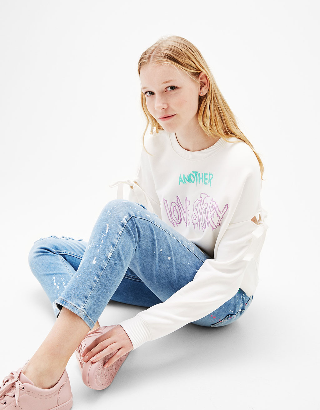 Off-shoulder sweatshirt with embroidered text