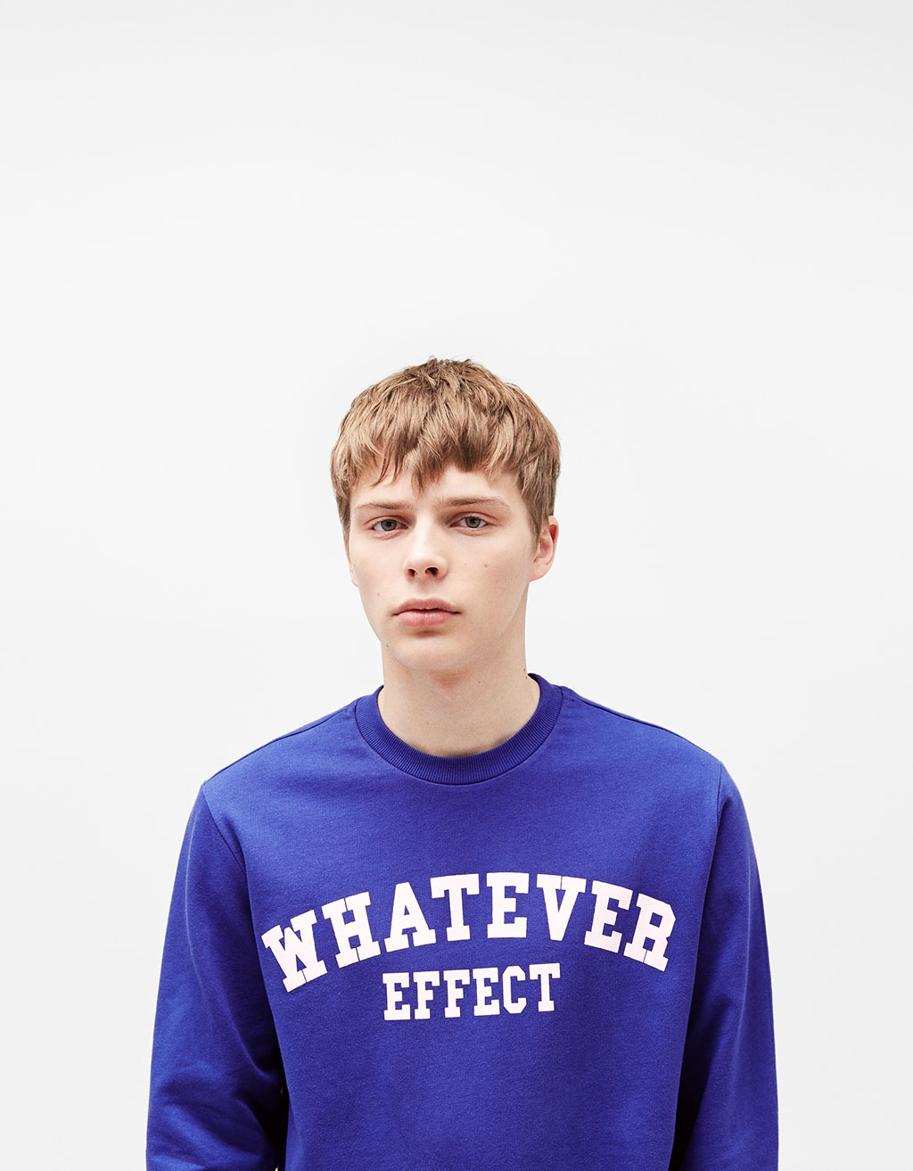 "Sweatshirt with ""Whatever"" slogan"