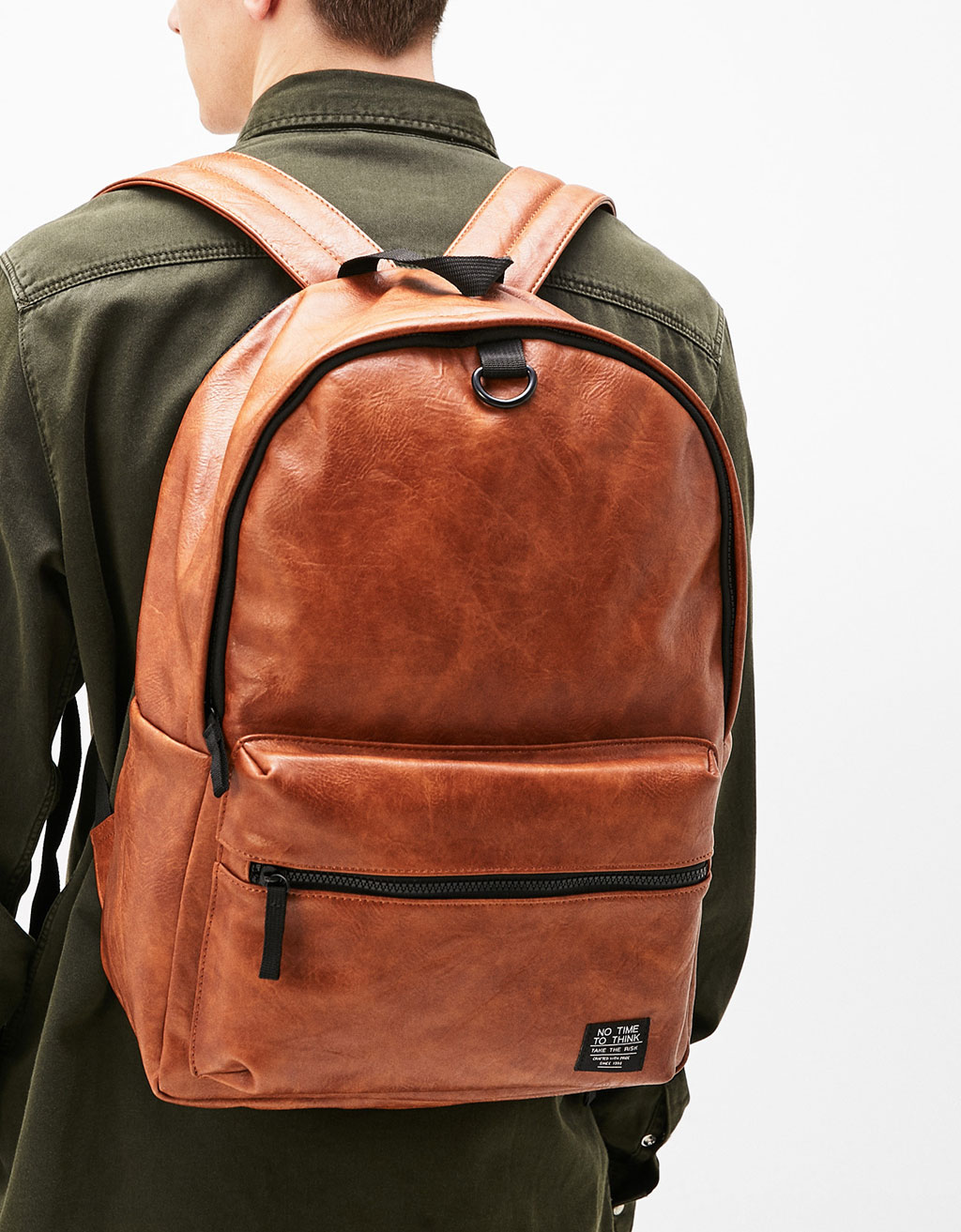 Backpack with contrasting zips