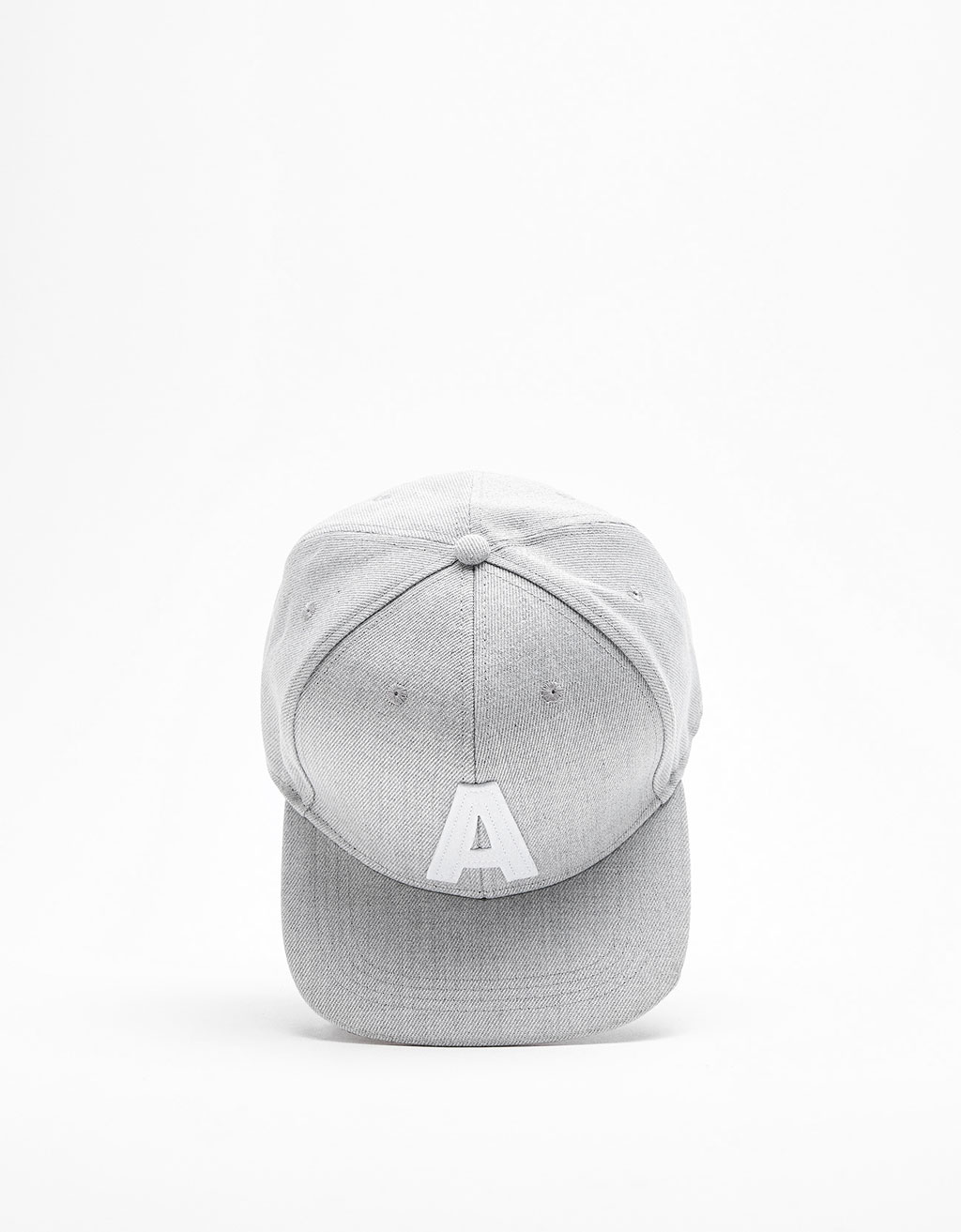 Textured cap with letter patch