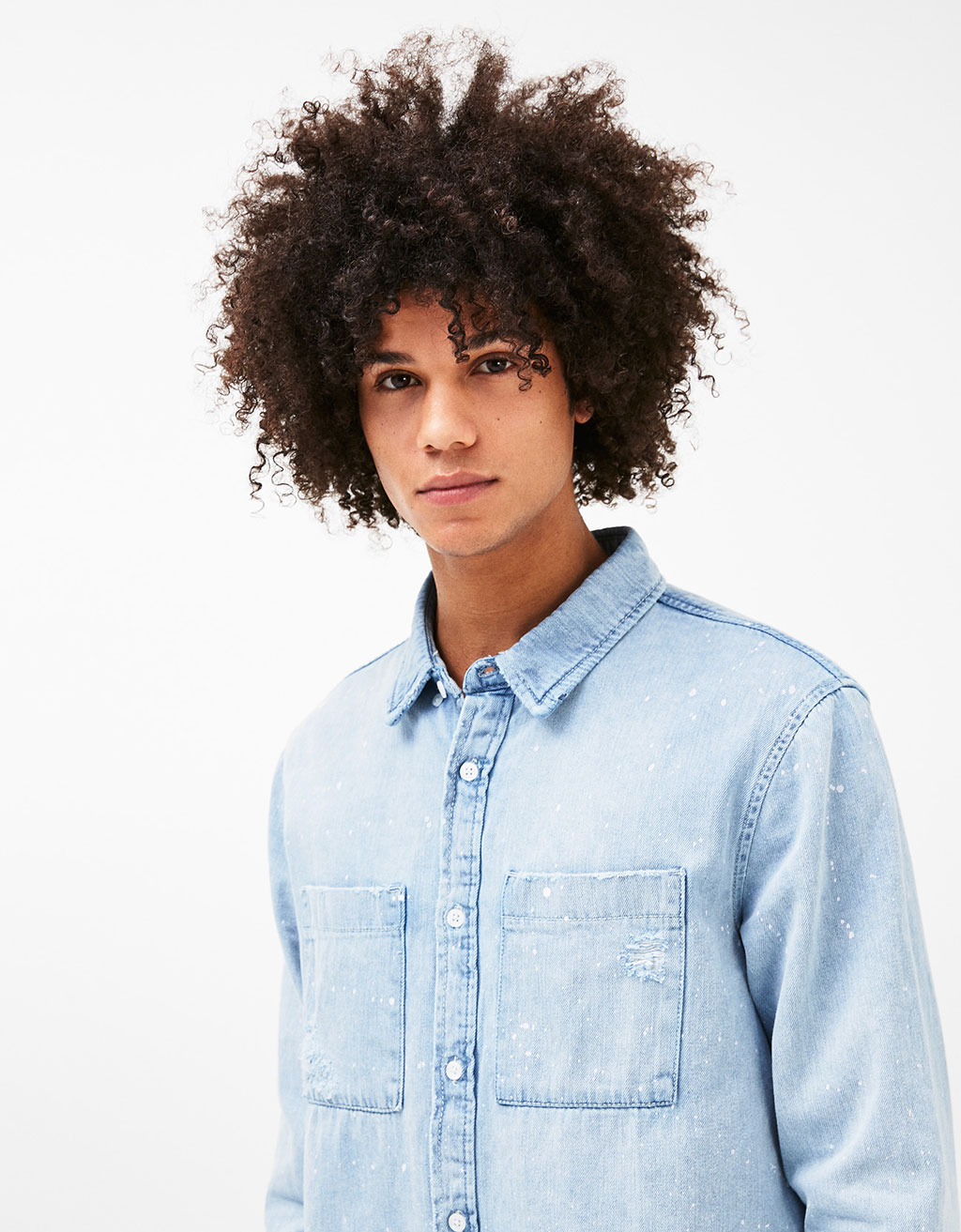 Denim shirt with ripped pockets