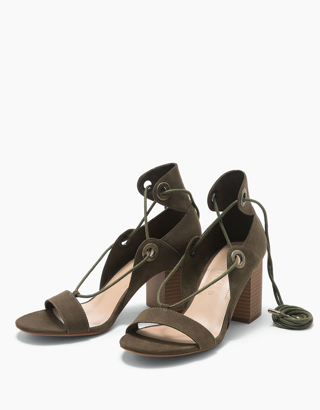 Tied mid-heeled sandals with grommets