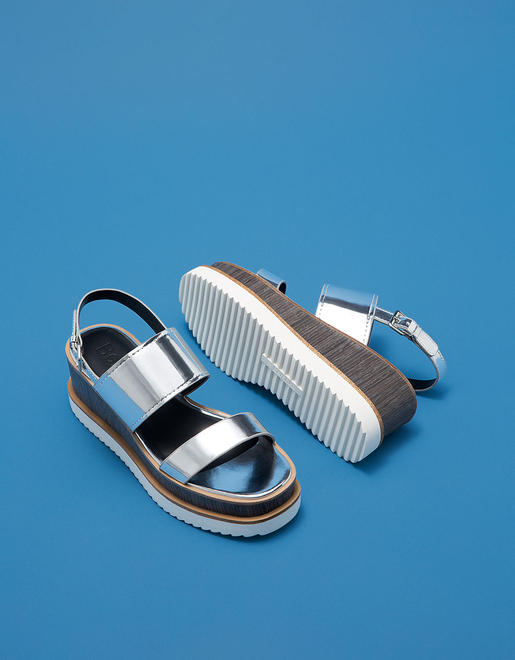 Shiny metallic wedge slides