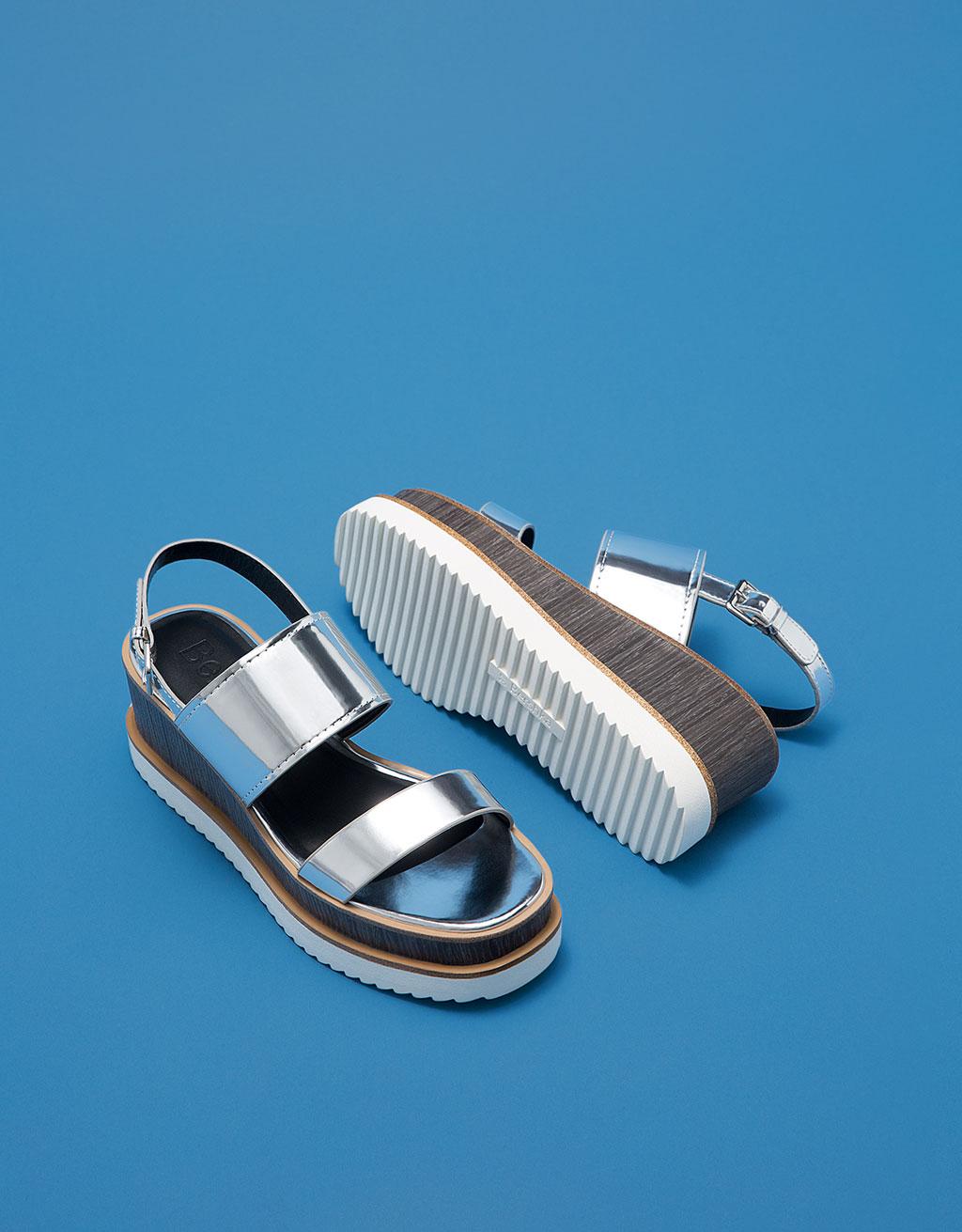 Shiny metallic wedge slides