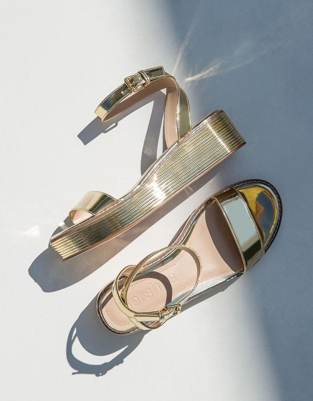 Metallic wedge sandals with ankle strap