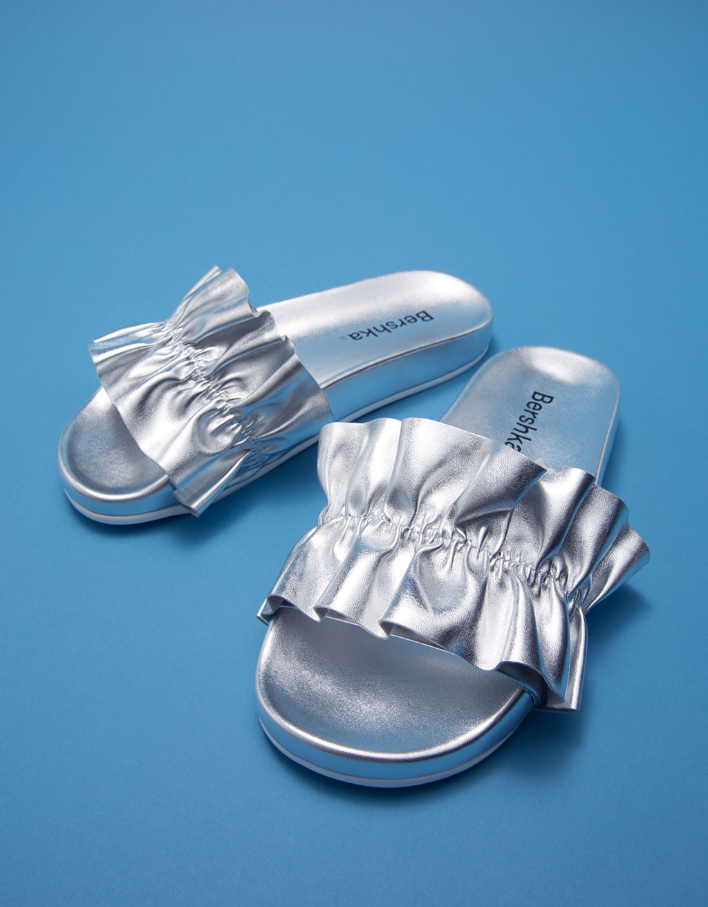 Shiny slides with metallic frills