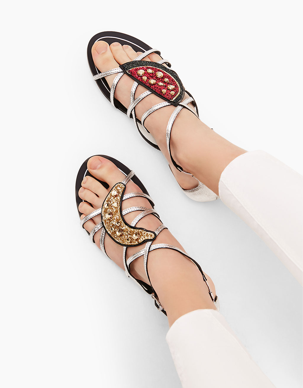 Flat sandals with metallic straps and gems