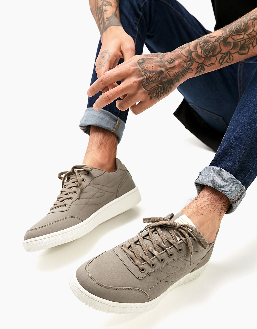 Men's lace-up fabric sports shoes with topstitching detail