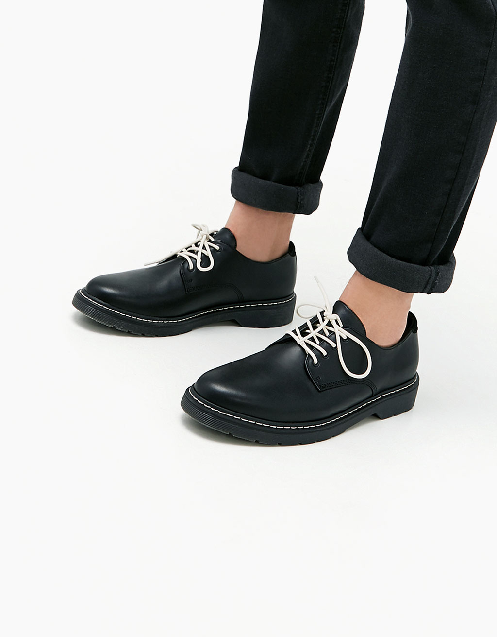 Men's lace-up dress shoes with contrasting topstitching detail