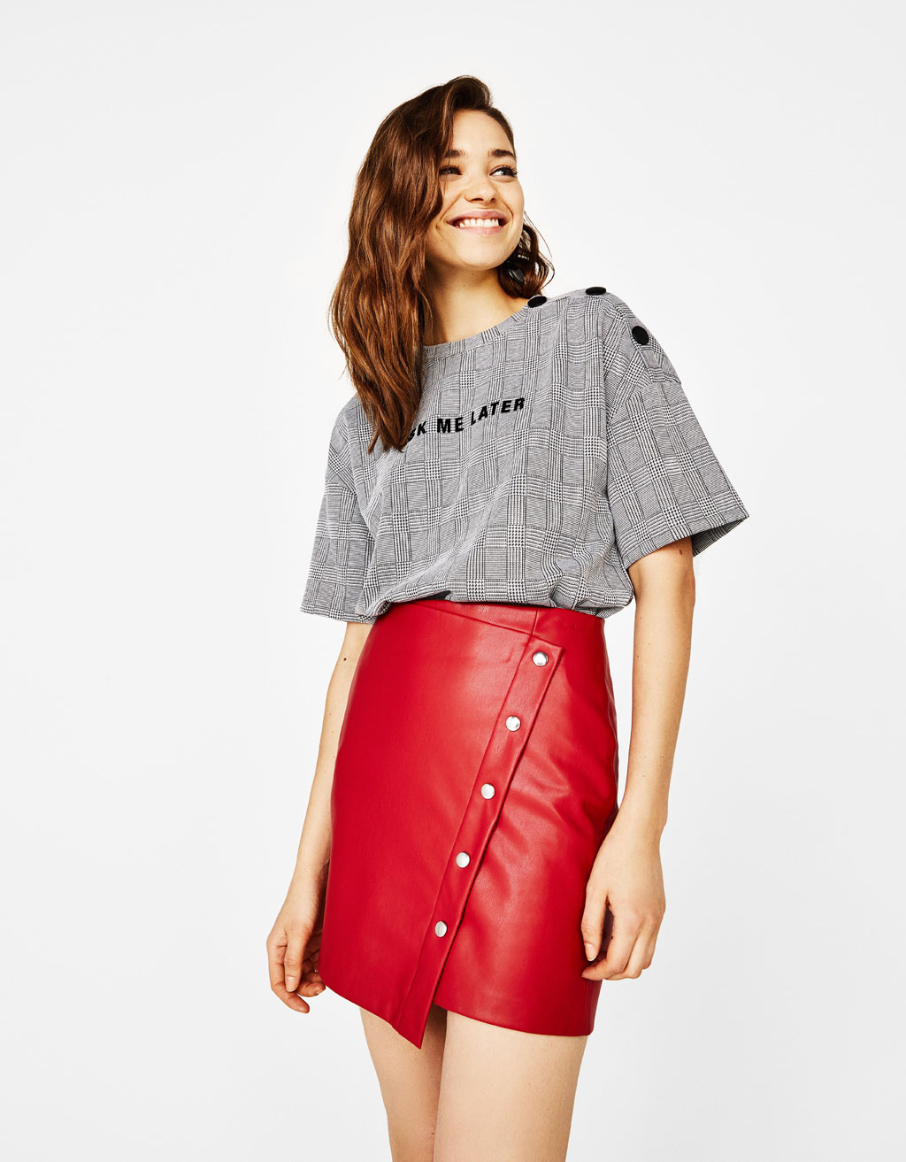 Faux leather skirt with press stud buttons