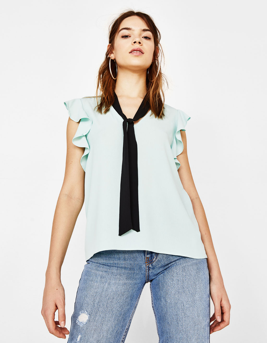 Ruffled shirt with a bow