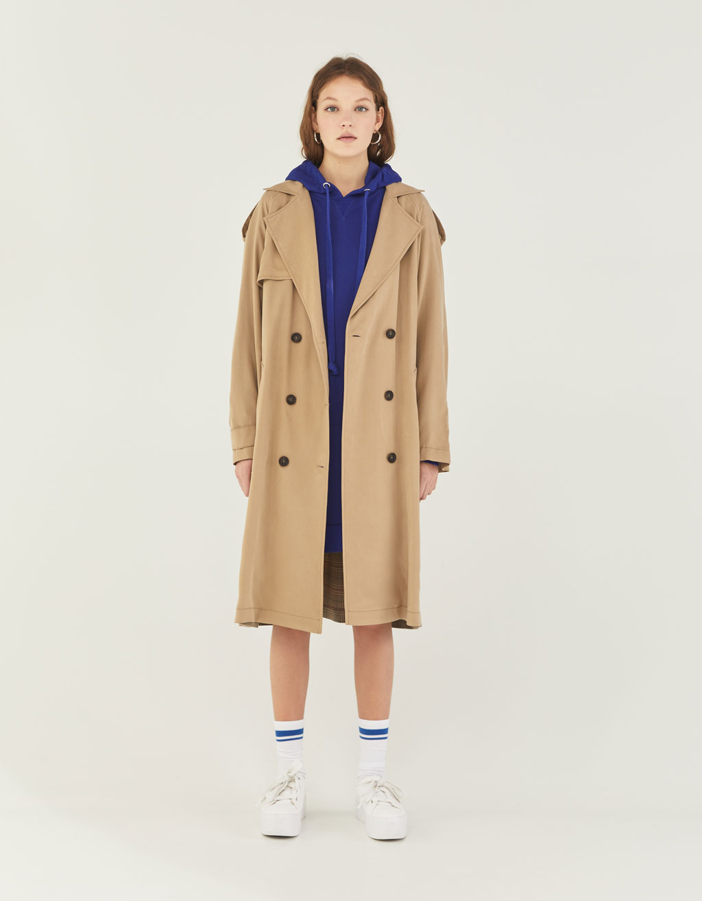 Contrasting checked trench coat