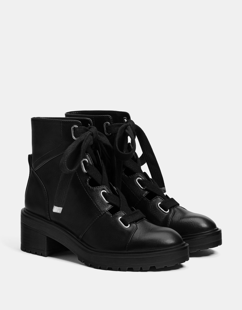 Openwork ankle boots with metal eyelets