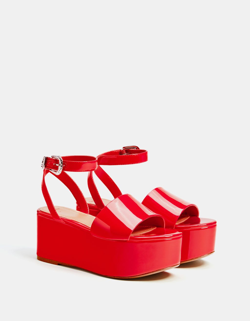 Red faux patent leather platform sandals