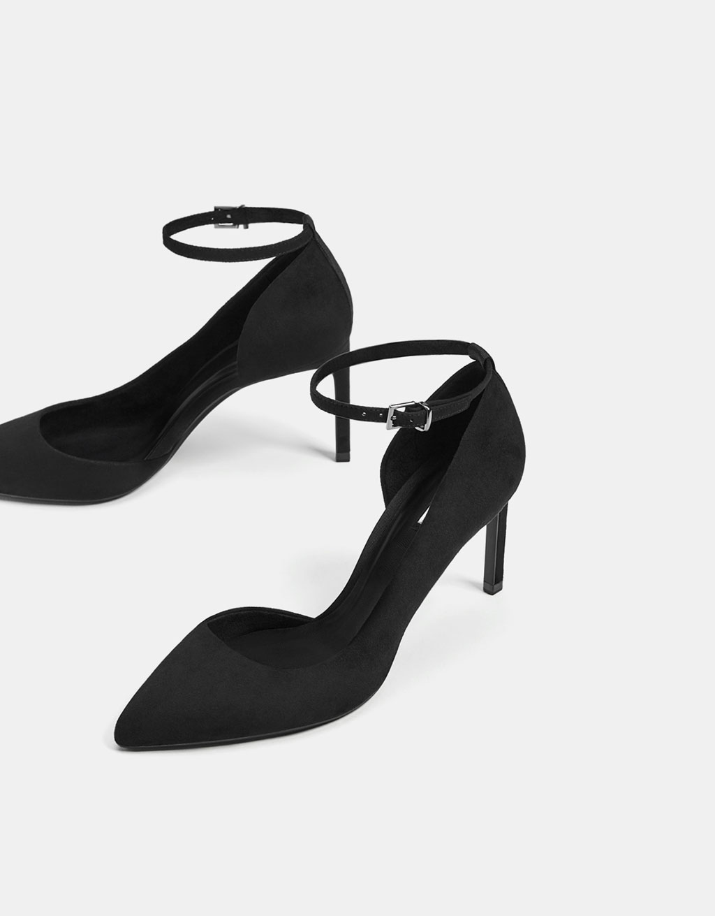 Asymmetric high heel shoes with ankle straps