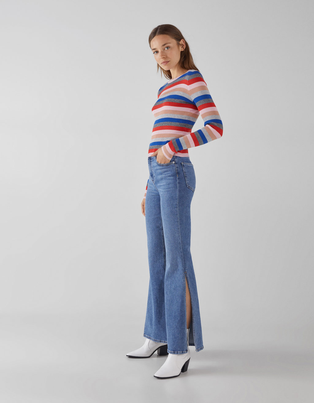 High waist flared jeans with side opening