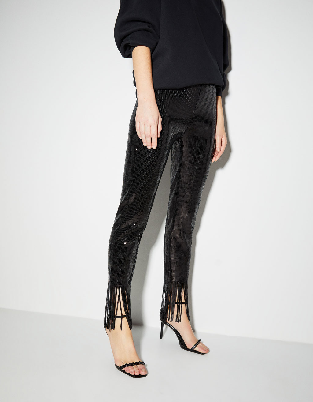Sequined pants with fringe trims