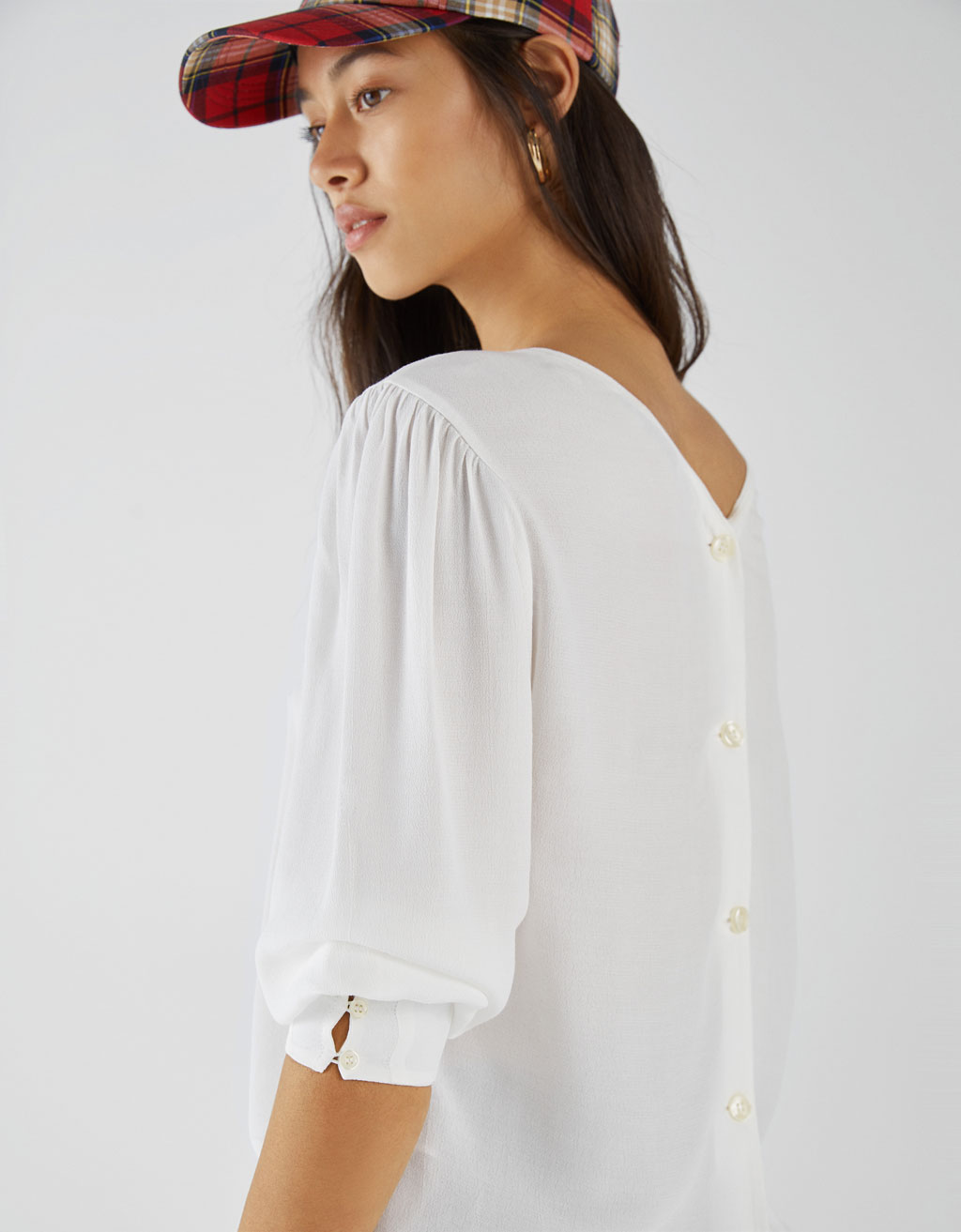 Blouse with buttons on the back